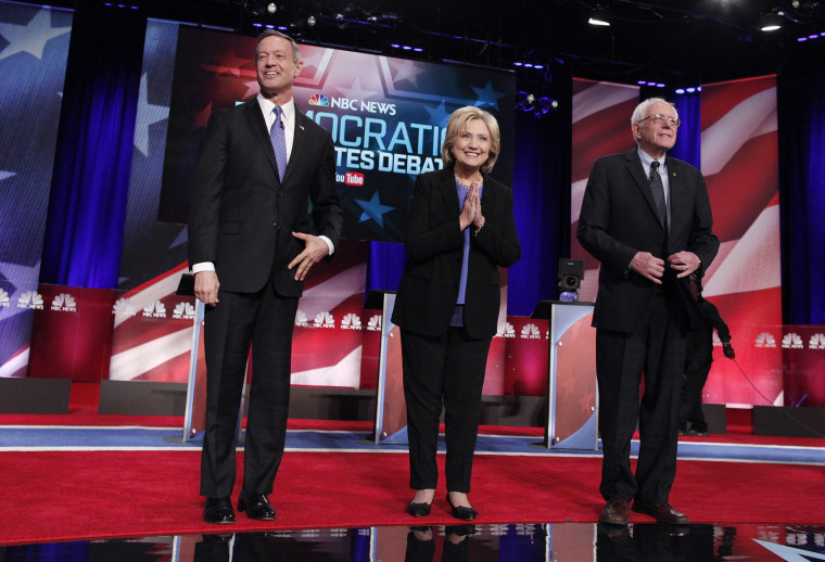 Democratic U.S. presidential candidates Martin O'Malley, Hillary Clinton and Senator Bernie Sanders pose together before the start of the NBC News - YouTube Democratic presidential candidates debate, Jan. 17, 2016. (Photo by Randall Hill/Reuters)