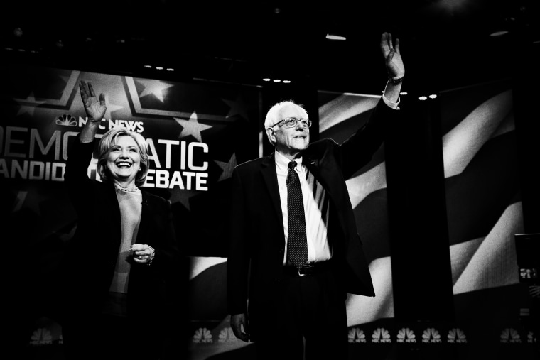Democratic presidential candidates Hillary Clinton and Sen. Bernie Sanders (R) stand together before the start of the NBC, YouTube Democratic presidential debate at the Gaillard Center, January 17, 2016, in Charleston, S.C.