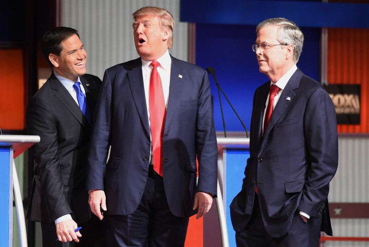 Republican presidential candidates Donald Trump, Sen. Marco Rubio, R-Fla. and Jeb Bush speak at a break during the Fox Business Network Republican presidential debate at the North Charleston Coliseum, Jan. 14, 2016. (Photo by Rainier Ehrhardt/AP)