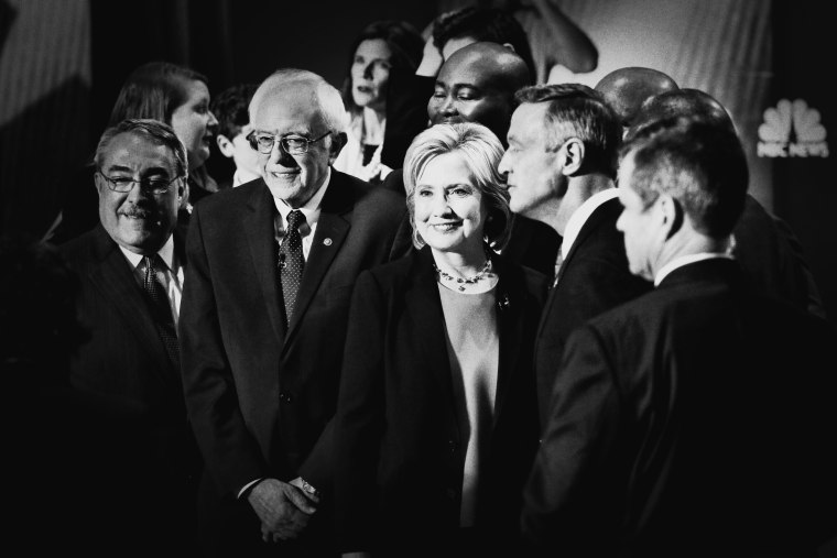 Democratic presidential candidates Martin O'Malley, Hillary Clinton and Bernie Sanders (gather after the NBC, YouTube Democratic presidential debate at the Gaillard Center, January 17, 2016, in Charleston, S.C.