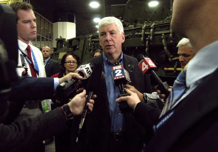 Michigan Governor Rick Snyder talks to reporters during the press preview for the 2016 North American International Auto Show at Cobo Hall, Jan. 12, 2016 in Detroit, Mich. (Photo by Paul Warner/Getty)