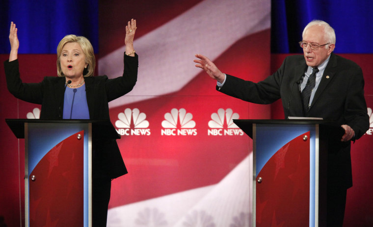 Democratic U.S. presidential candidate Hillary Clinton and rival candidate U.S. Senator Bernie Sanders speak simultaneously at the NBC News - YouTube Democratic presidential candidates debate, Jan. 17, 2016. (Photo by Randall Hill/Reuters)