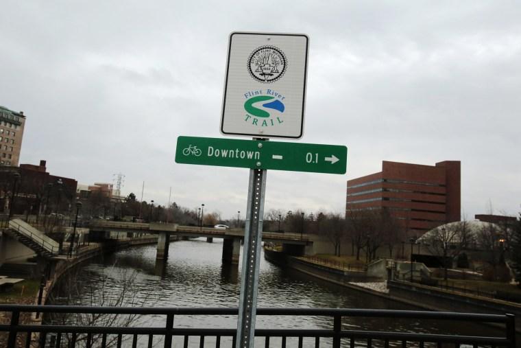 A Flint River sign is seen in Flint, Mich., Dec. 16, 2015. (Photo by Rebecca Cook/Reuters)