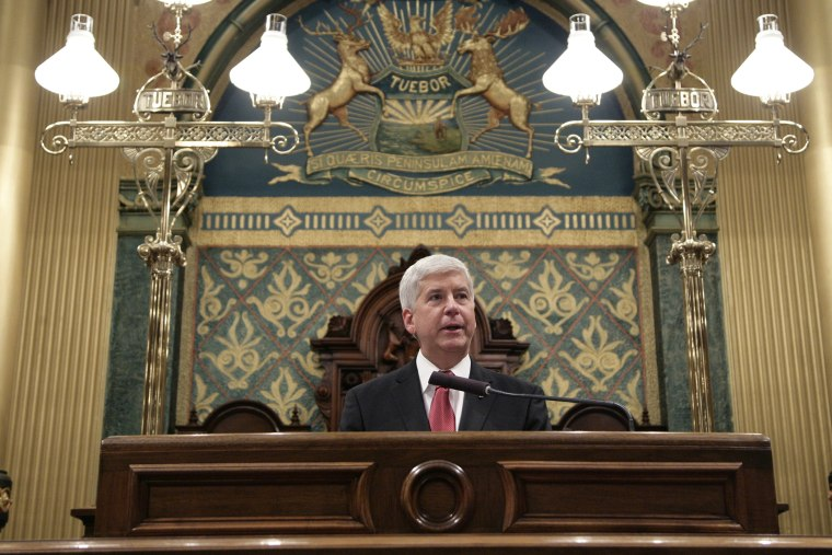 Michigan Gov. Rick Snyder delivers his State of the State address to a joint session of the House and Senate, Jan. 19, 2016, at the state Capitol in Lansing, Mich. (Photo by Al Goldis/AP)