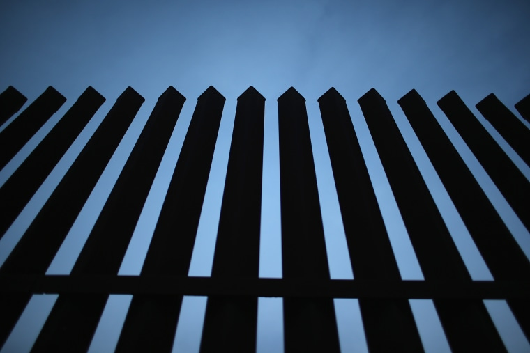 The U.S.-Mexico border fence stands on Dec. 8, 2015 near McAllen, Texas. (Photo by John Moore/Getty)