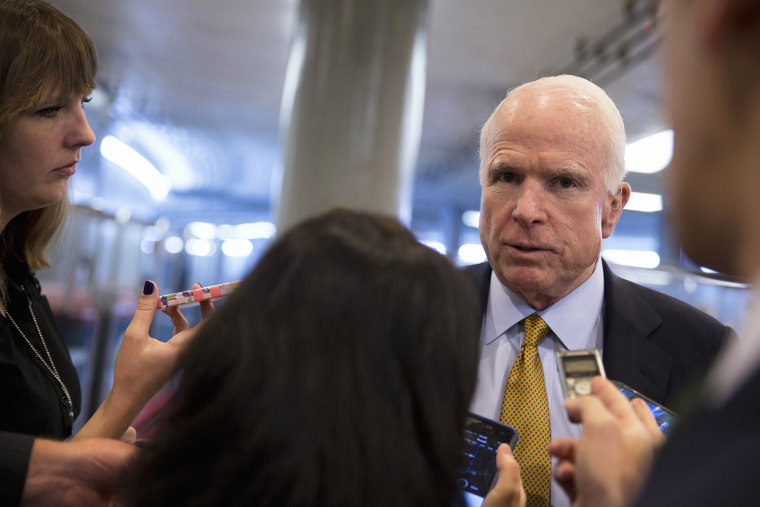 In this Oct. 20, 2015 photo Sen. John McCain, R-Ariz., talks to reporters near the subway on Capitol Hill in Washington, D.C. (Photo by Carolyn Kaster/AP)