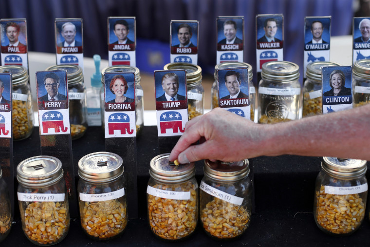 A visitor casts their vote with a kernel of corn for presidential candidate Donald Trump in a straw poll at the Iowa State Fair, Aug. 20, 2015, in Des Moines, Iowa. (Photo by Paul Sancya/AP)