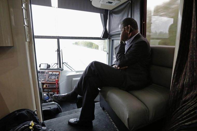 Republican presidential candidate, retired neurosurgeon Ben Carson answers a question during a phone interview as he travels on his bus tour near Lexington, N.C., Sept. 28, 2015. (Photo by Chuck Burton/AP)