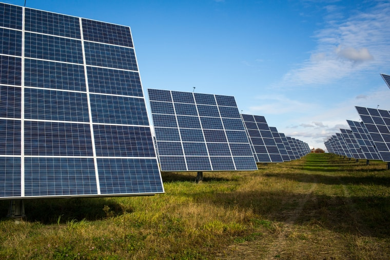 An array of 366 solar tracking devices stand in a field Oct. 31, 2014 in South Burlington, Vt. (Photo by Robert Nickelsberg/Getty)