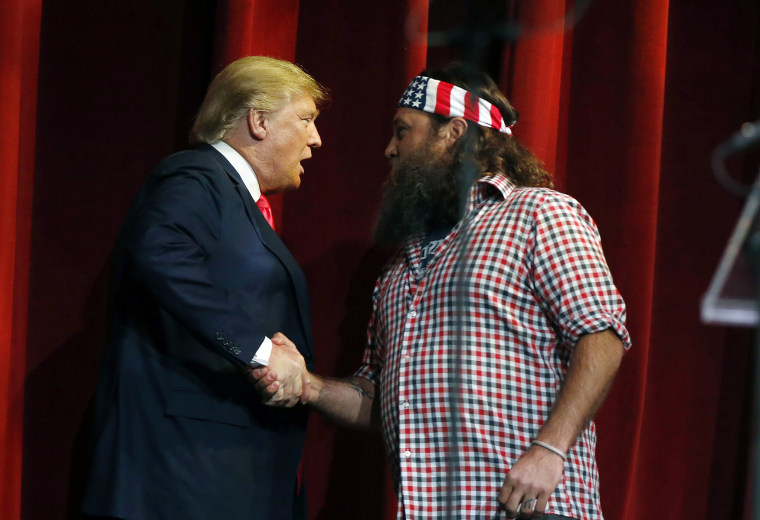Willie Robertson welcomes Republican presidential candidate Donald Trump to the stage during the Outdoor Channel and Sportsman Channel's 16th annual Outdoor Sportsman Awards, Jan. 21, 2016, in Las Vegas. (Photo by Isaac Brekken/AP)