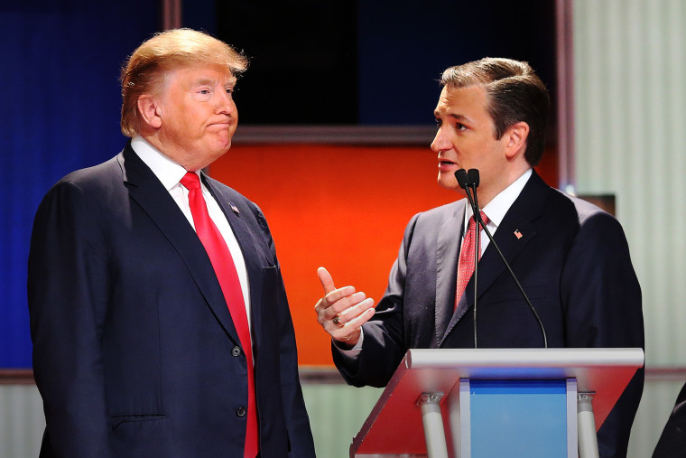 Republican presidential candidates Donald Trump and Sen. Ted Cruz (R-TX) speak during a commercial break in the sixth Republican presidential debate in North Charleston, S.C., on Jan. 14, 2016. (Photo by Scott Olson/Getty)