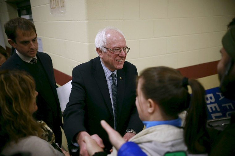 U.S. Democratic presidential candidate Senator Bernie Sanders shakes hands with an attendee during a campaign town hall meeting in Bedford, N.H. Jan. 22, 2016. (Photo by Katherine Taylor/Reuters)