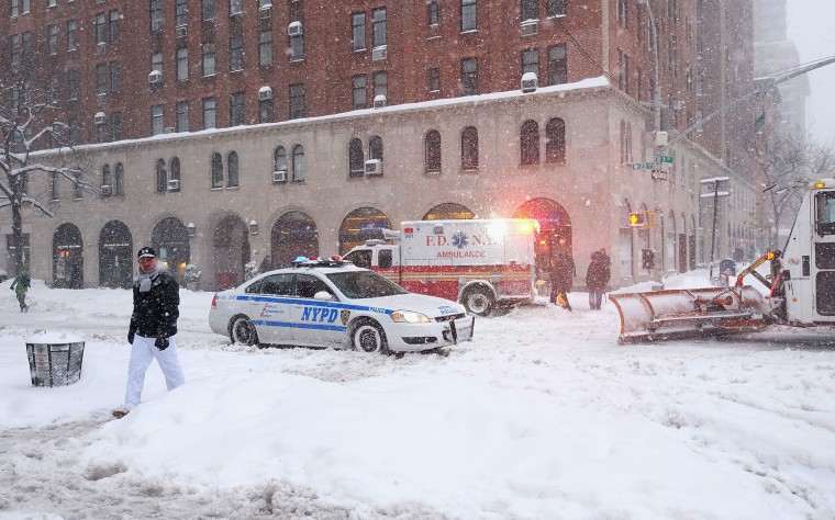 Emergency Vehicles in the empty streets in Chelsea during blizzard conditions on Jan. 23, 2016 in New York. (Photo by Jamie McCarthy/Getty)