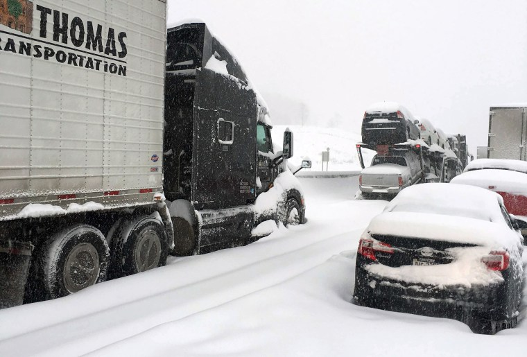 In this photo provided by Michael Watkins, traffic is at a standstill on the Pennsylvania Turnpike near Bedford, Pa., Jan. 23, 2016. (Photo by Michael Watkins/AP)