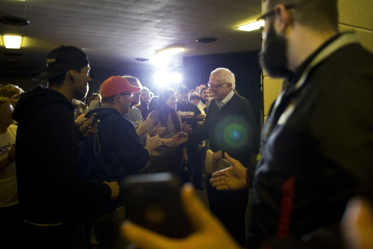 Democratic presidential candidate Sen. Bernie Sanders, I-Vt., shakes hands with supporters as he arrives at a campaign event, Jan. 23, 2016, in Clinton, Ia. (Photo by Jae C. Hong/AP)