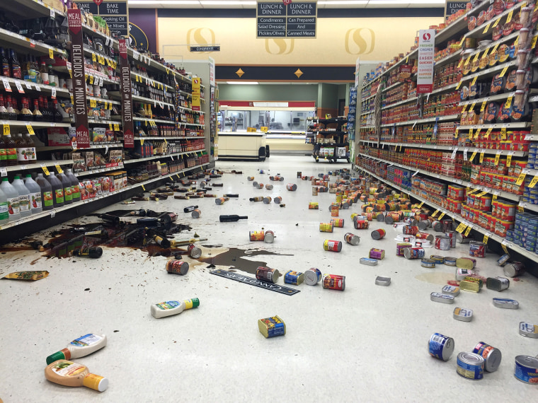 Items fallen from the shelves litter the aisles inside a Safeway grocery store following a magnitude 6.8 earthquake on the Kenai Peninsula, Jan. 24, 2016, in south-central Alaska. (Photo by Vincent Nusunginya/AP)