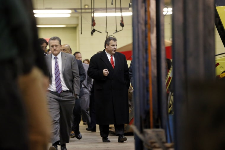 New Jersey Gov. Chris Christie leaves a boardroom at the Newark Department of Transportation after hearing a briefing ahead of a snowstorm, Jan. 22, 2016, in Newark, N.J. (Photo by Julio Cortez/AP)
