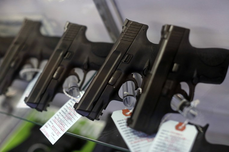 Handguns are seen for sale in a display case. (Photo by Jim Young/Reuters)