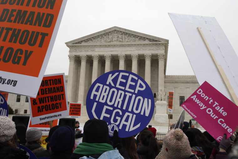Pro-choice signs are seen during the March for Life 2016, in front of the U.S. Supreme Court, Jan. 22, 2016. (Photo by Alex Brandon/AP)