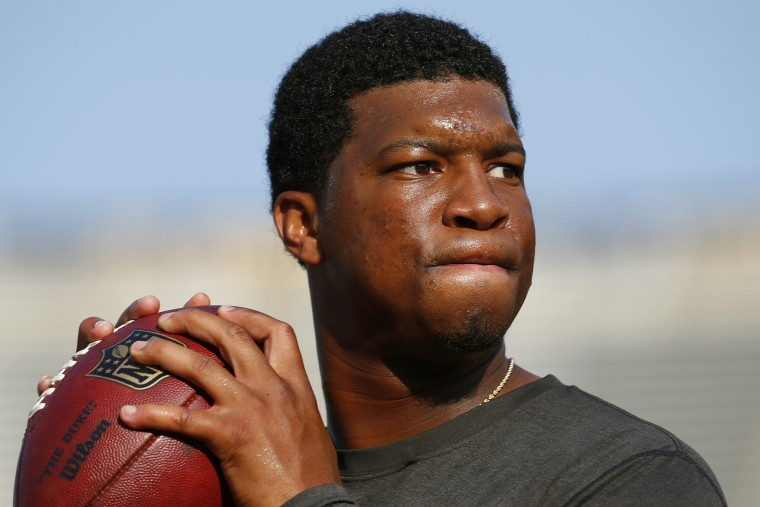 In this Aug. 15, 2015, file photo, Tampa Bay Buccaneers quarterback Jameis Winston warms up before a preseason NFL game. (Photo by Paul Sancya/AP)