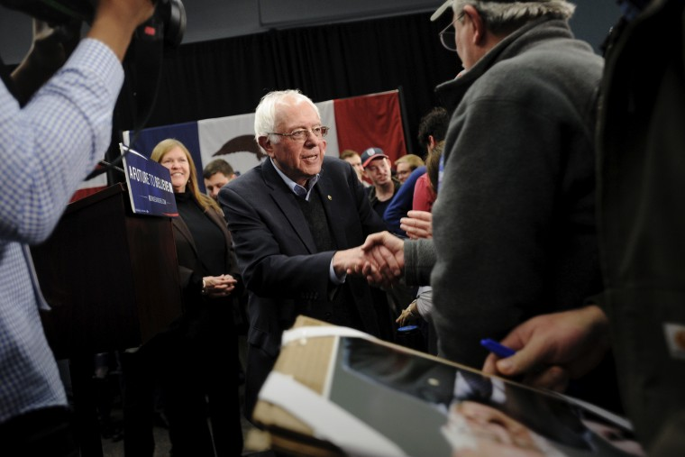 Democratic presidential candidate Bernie Sanders greets supporters after speaking at a town hall in Independence, Iowa, Jan. 24, 2016. (Photo by Mark Kauzlarich/Reuters)