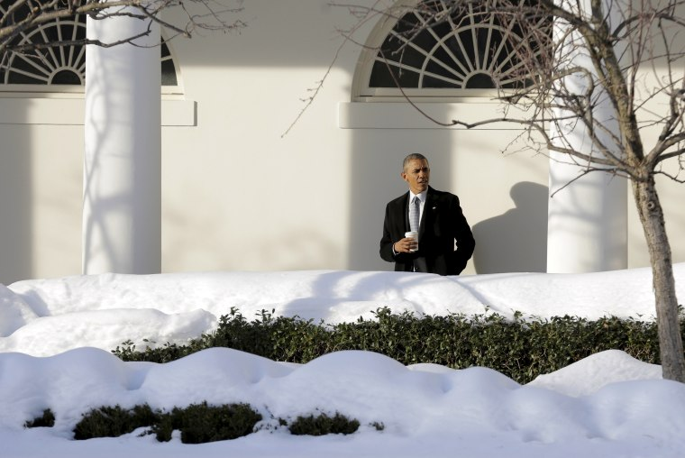 U.S. President Barack Obama waits for members of his staff in the Colonnade as he walks to the Oval Office at the White House in Washington Jan. 25, 2016. (Photo by Joshua Roberts/Reuters)