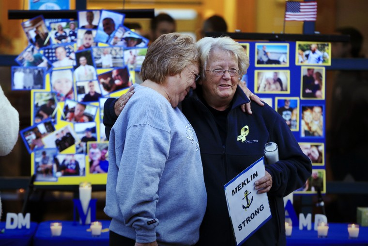 Deborah Dyer, right, is hugged by Judy Marzolf at vigil held at Maine Maritime Academy for the missing crew members of the U.S. container ship El Faro, Oct. 6, 2015, in Castine, Maine. (Photo by Robert F. Bukaty/AP)