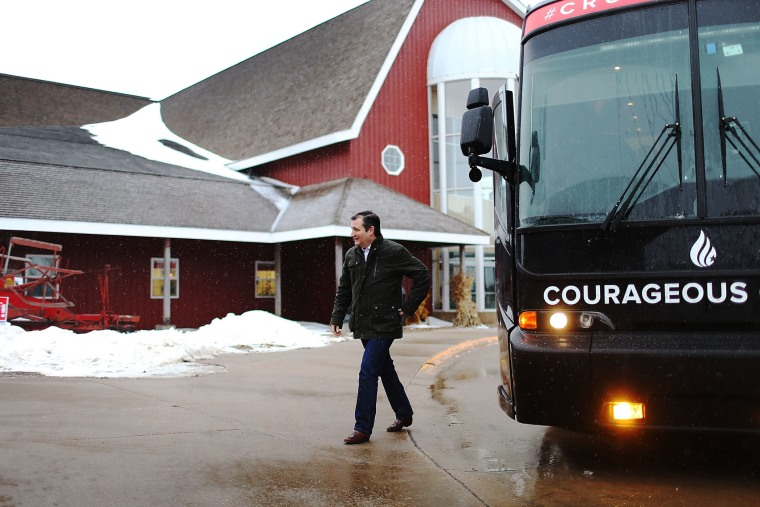 Republican presidential candidate Sen. Ted Cruz (R-TX) walks off his campaign bus for an event at the Heartland Acres Agribition Center on Jan. 25, 2016 in Independence, Iowa. (Photo by Joe Raedle/Getty)