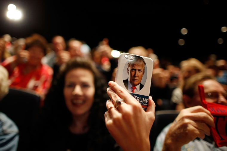 A supporter of Republican presidential candidate Donald Trump takes video on her Trump-branded phone during a campaign rally at the Treasure Island Hotel & Casino on Oct. 8, 2015 in Las Vegas, Nev. (Photo by Isaac Brekken/Getty)