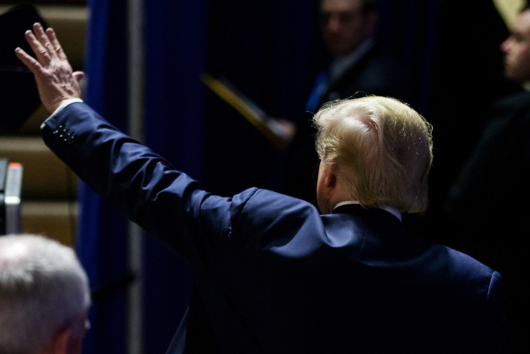 Republican presidential candidate Donald Trump waves to members of the audience as he departs after speaking at a rally at Muscatine High School in Muscatine, Iowa, Jan. 24, 2016. (Photo by Andrew Harnik/AP)