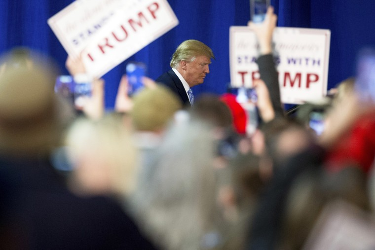Republican presidential candidate Donald Trump arrives to speak at a rally at Muscatine High School in Muscatine, Iowa, Jan. 24, 2016. (Photo by Andrew Harnik/AP)
