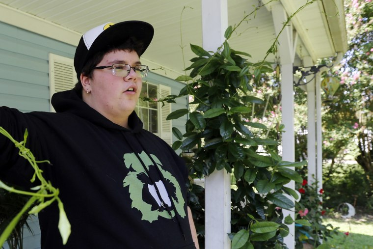 This Tuesday Aug. 25, 2015 photo shows Gavin Grimm leans on a post on his front porch during an interview at his home in Gloucester, Va. (Photo by Steve Helber/AP)