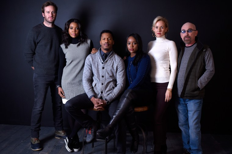 """(L-R) Actors Armie Hammer, Gabrielle Union, Nate Parker, Aja Naomi King, Penelope Ann Miller and Jackie Earle Haley from the film """"The Birth of a Nation"""" poses for a portrait on Jan. 25, 2016 in Park City, Utah. (Photo by Jeff Vespa/WireImage/Getty)"""