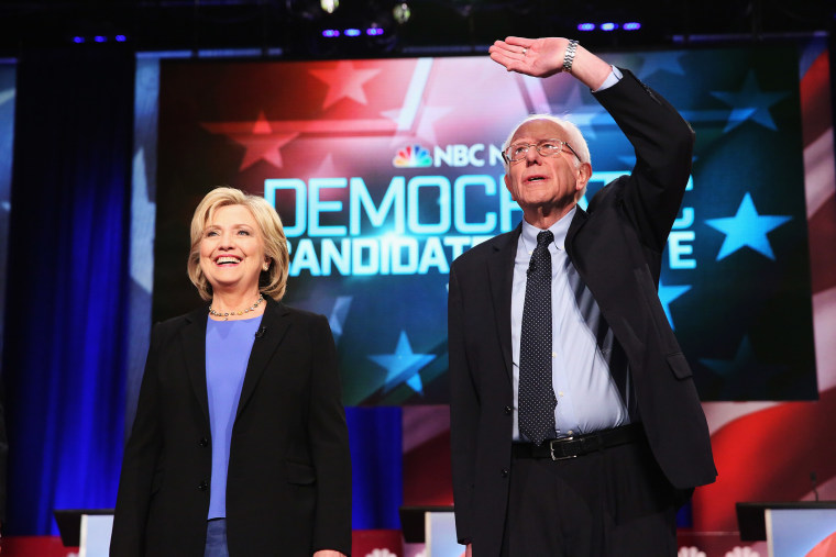 Candidates Hillary Clinton and Senator Bernie Sanders (I-VT) participate in the Democratic Candidates Debate hosted by NBC News and YouTube on Jan. 17, 2016 in Charleston, S.C. (Photo by Andrew Burton/Getty)