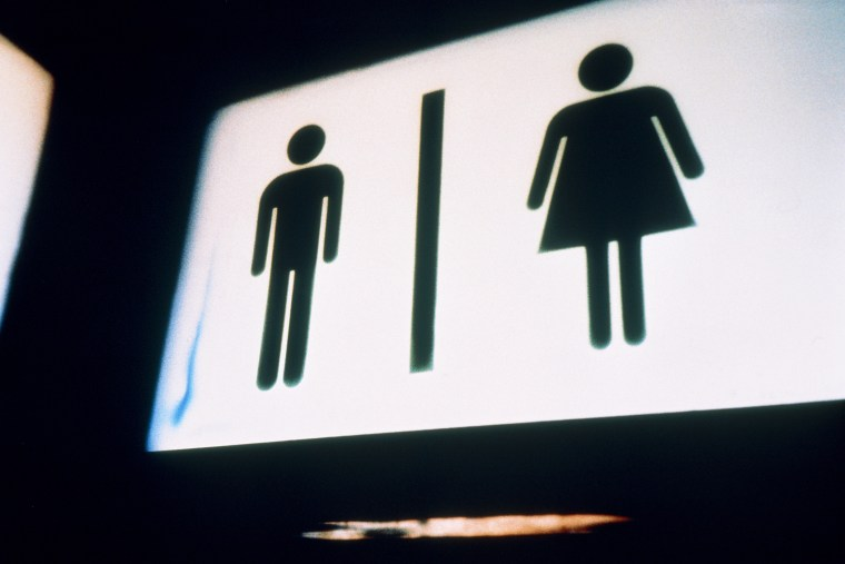 A sign for men and women's bathrooms. (Photo by Vincent Mo/Corbis)