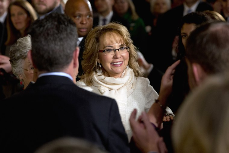 People applaud former Ariz. Rep. Gabby Giffords as she arrives in the East Room of the White House in Washington on Jan. 5, 2016. (Photo by Jacquelyn Martin/AP)