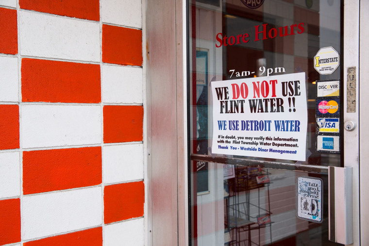 A sign at a local restaurant reassures customers that they are not on Flint water but on uncontaminated water pulled from Detroit on Jan. 27, 2016 at Westside Diner in Flint, Mich. (Photo by Brett Carlsen/Getty)