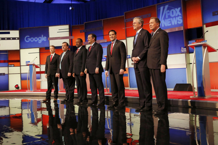 Republican U.S. presidential candidates pose together onstage at the debate held by Fox News in Des Moines, Iowa, Jan. 28, 2016. (Photo by Carlos Barria/Reuters)