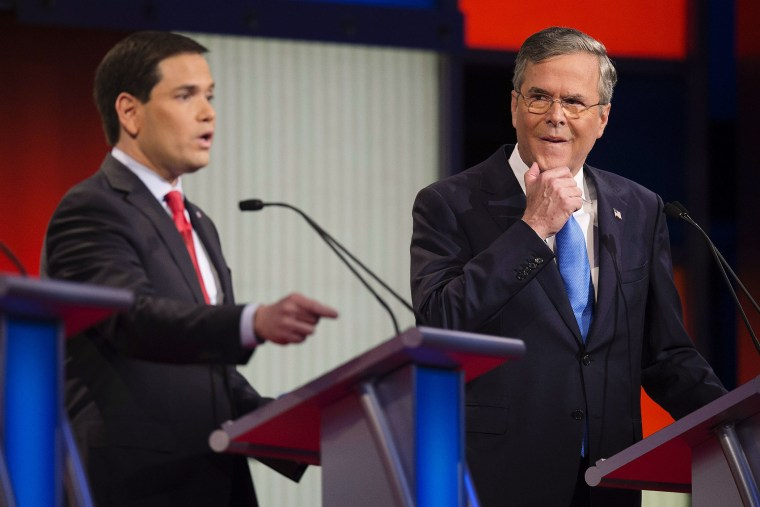 Republican Presidential candidate Florida Senator Marco Rubio speaks as former Florida Gov. Jeb Bush looks on during the debate at the Iowa Events Center in Des Moines, Iowa on Jan. 28, 2016. (Photo by Jim Watson/AFP/Getty)