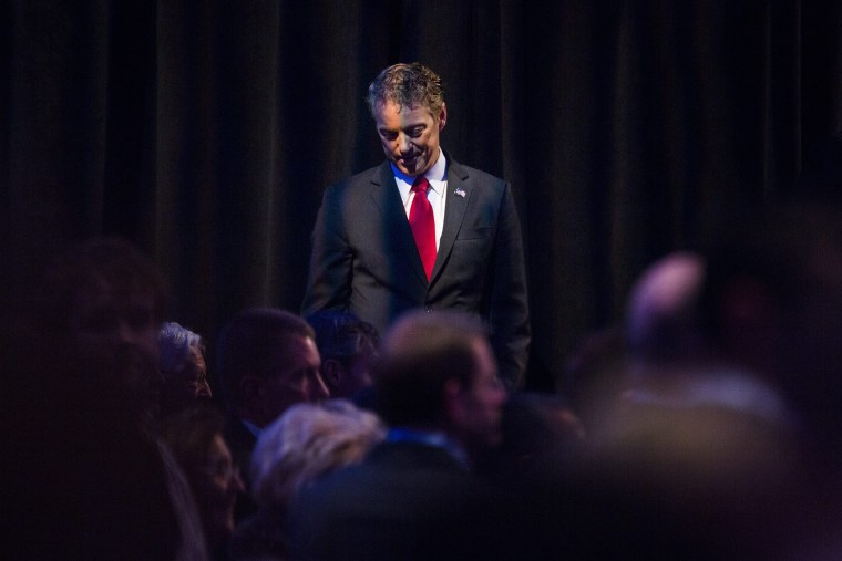 Kentucky Senator Rand Paul rests during a break in a Republican Presidential debate at the Iowa Events Center in Des Moines, Iowa, Jan. 28, 2016. (Photo by Jim Lo Scalzo/EPA)