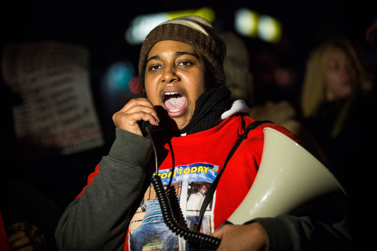 Erica Garner, daughter of Eric Garner, leads a march protesting in Staten Island, N.Y., after a grand jury's decision not to indict a police officer involved in her father's chokehold death in July, on Dec. 11, 2014. (Photo by Andrew Burton/Getty)