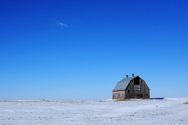 A traditional barn adorns the snow covered vast grand plains of Iowa on Jan. 29, 2016 in Carrol County, Iowa. (Photo by Christopher Furlong/Getty)