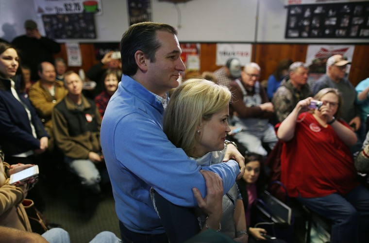 Republican presidential candidate Sen. Ted Cruz (R-TX) hugs his wife, Heidi Cruz, before he is introduced during a campaign event at 3 Generations Bar & Grill on Jan. 29, 2016 in Ringsted, Ia. (Photo by Joe Raedle/Getty)