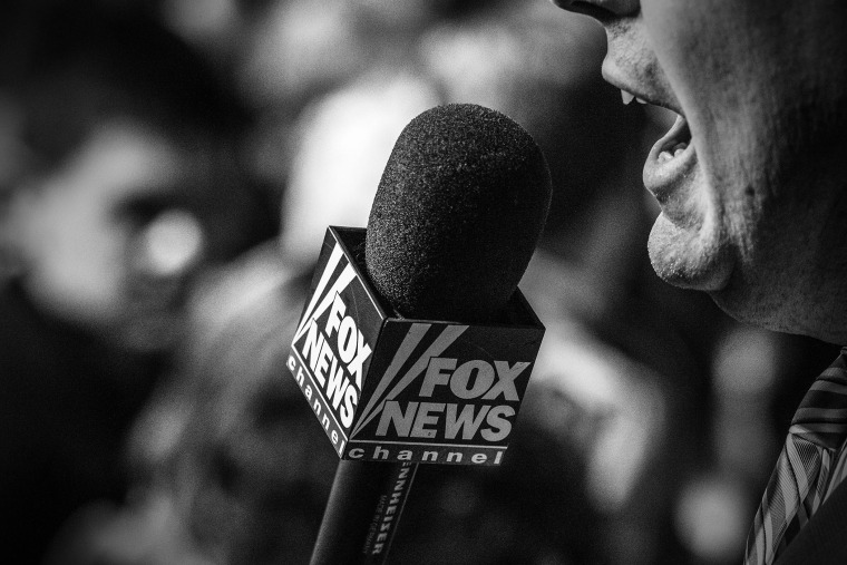 A Fox News reporter works from the Bernie Sanders rally in Iowa City, Ia., Jan. 30, 2016. (Photo by Mark Peterson/Redux for MSNBC)