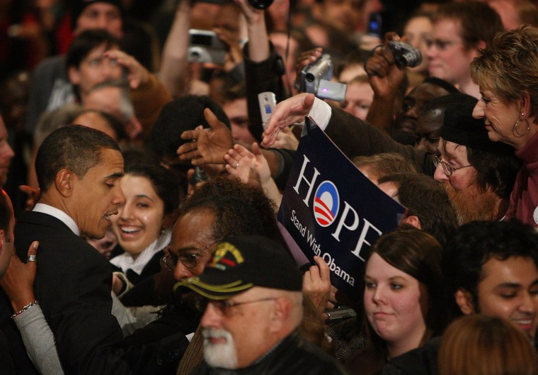 Then-Democratic Presidential hopeful Senator Barack Obama (D-IL) greets supporters gathered for a post-caucus celebration at the Hy-Vee Center, Jan. 3, 2008 in Des Moines, Ia. (Photo by Scott Olson/Getty)