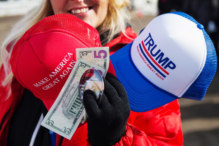 A vendor sells merchandise outside a rally for Republican presidential candidate Donald Trump at the airport on Jan. 29, 2016 in Dubuque, Iowa. (Photo by Scott Olson/Getty)