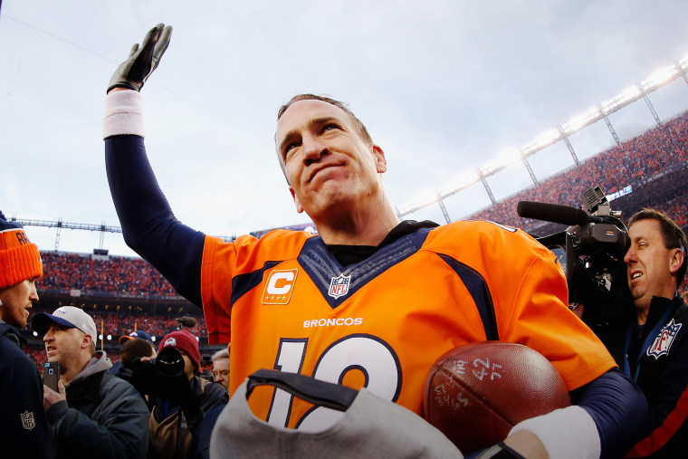 Quarterback Peyton Manning #18 of the Denver Broncos waves after defeating the New England Patriots at the AFC Championship game, Jan. 24, 2016 in Denver, Colo. (Photo by Christian Petersen/Getty)