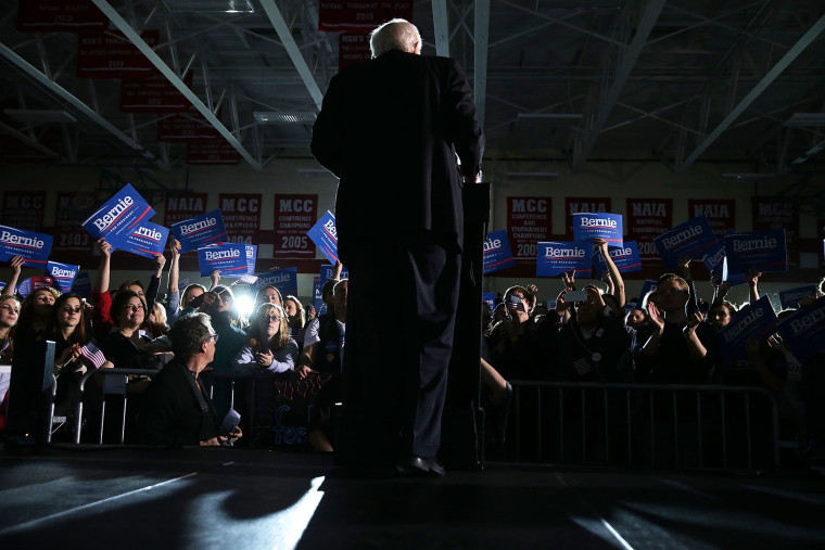 Supporters react as Democratic presidential candidate Sen. Bernie Sanders (I-VT) speaks during a campaign event at Grand View University Jan. 31, 2016 in Des Moines, Iowa. (Photo by Alex Wong/Getty)