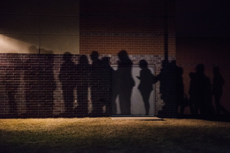 The shadows of caucus goers lined up outside a Democrat Party caucus can be seen on the walls of Maple Grove Elementary in West Des Moines, Iowa. (Photo by Stephen Maturen/Getty)