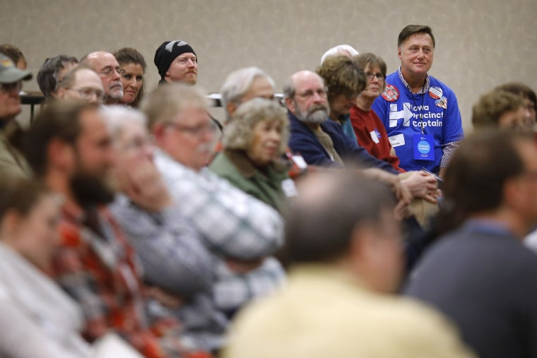 John Grause, top right, precinct captain for Democratic presidential candidate Hillary Clinton, sits with voters during a Democratic party caucus in Nevada, Iowa, Feb. 1, 2016. (Photo by Patrick Semansky/AP)